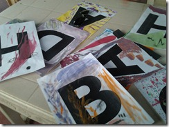 Alphabets of the Bhadaas Dho Slogan being painted by volunteers