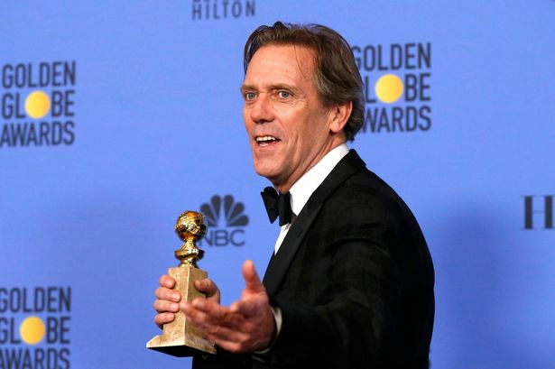 hugh-laurie-holds-his-award-during-the-74th-annual-golden-globe-awards-in-beverly-hills